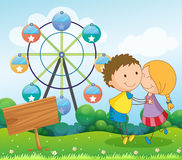 A couple dating near the ferris wheel and the empty wooden signb. Illustration of a couple dating near the ferris wheel and the empty wooden signboard Royalty Free Stock Images