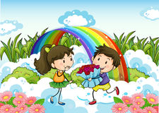 A couple dating near the rainbow Stock Image