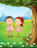 A couple dating near the tree Royalty Free Stock Photography