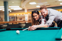Couple dating and playing snooker Royalty Free Stock Images