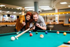 Couple dating and playing snooker Royalty Free Stock Image
