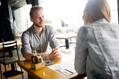 Couple dating in restaurant. And enjoying each other`s company royalty free stock images