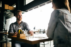 Couple dating in restaurant. And enjoying each other`s company Royalty Free Stock Photos