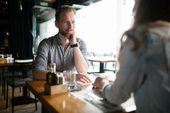 Couple dating in restaurant. And enjoying each other`s company Royalty Free Stock Photo