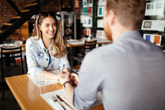 Couple dating in restaurant. And enjoying each other`s company Stock Photos