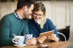 Couple dating in restaurant. Couple in love dating in restaurant stock images