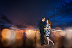 Couple in dating on sunset and abstract background Royalty Free Stock Photo