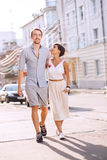 Couple dating in town at sunny day. Walking on sidewalk Stock Photography