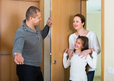 Couple with daughter at the doorway Stock Photos