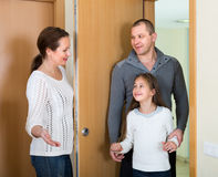 Couple with daughter at the doorway Stock Images