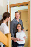 Couple with daughter at the doorway Stock Photography