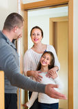 Couple with daughter at the doorway Royalty Free Stock Photos