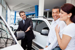Couple at the dealership Stock Photography