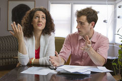 Couple dealling with bills, horizontal Stock Photography