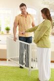 Couple deciding on baby bed Royalty Free Stock Image