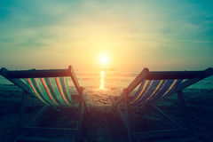 A couple of deck chairs at dusk on sea beach. Relax. Royalty Free Stock Photos