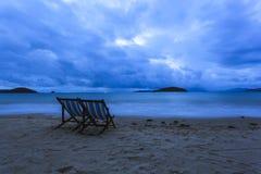 Couple deckchairs on beach as blue tone Royalty Free Stock Photo