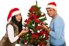Couple decorate Christmas tree Royalty Free Stock Images