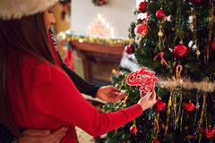 Couple decorate Christmas tree, close up Stock Photography