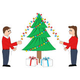 A couple decorating Christmas tree Stock Photography