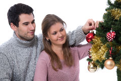 Couple decorating Christmas tree stock photo