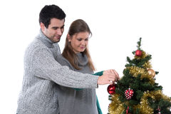 Couple decorating Christmas tree royalty free stock images