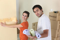 Couple decorating home Stock Photo