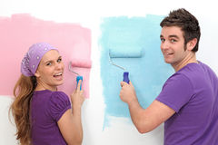 Couple decorating painting Stock Image