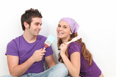 Couple decorating painting Royalty Free Stock Photo