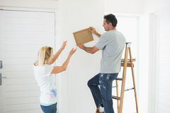 Couple decorating their new house Royalty Free Stock Images