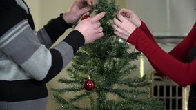 Couple decorating tree at Christmas time stock footage