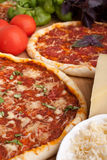 Couple of delicious pizzas with ingredients Stock Images