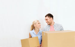 Couple with delivery boxes moving to new home Stock Image