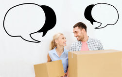 Couple with delivery boxes moving to new home Royalty Free Stock Photos