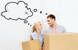 Couple with delivery boxes moving to new home Royalty Free Stock Photography