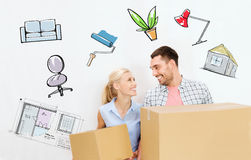 Couple with delivery boxes moving to new home Royalty Free Stock Images