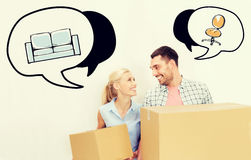 Couple with delivery boxes moving to new home Stock Images