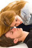 Couple demonstrating first aid techniques with. Female helper placing her ear over patients mouth listening Royalty Free Stock Image