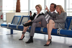 Couple in departure lounge. Businessmen and women in departure lounge stock photos