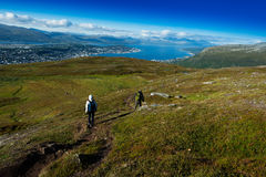 Couple descending from Norway mountain background Stock Photography