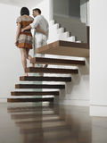 Couple Descending Stairs Royalty Free Stock Photos