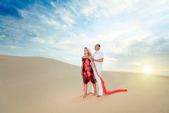 Couple in desert Stock Photo