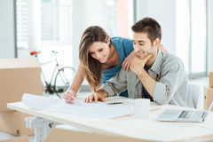 Couple designing their dream house Stock Photo