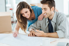 Couple designing their new house Stock Photo