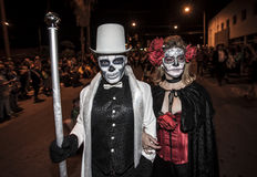 Couple in Dia De Los Muertos Procession Stock Photo