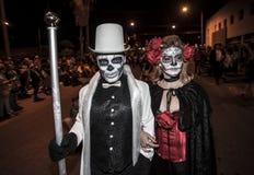 Couple in Dia De Los Muertos Procession Stock Photo