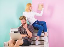Couple with different interests spend time together. Focus of interest. Girl and guy interested in intellectual activity royalty free stock photos