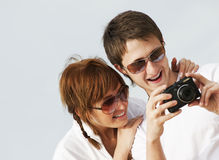 Couple with a digital camera Stock Photos