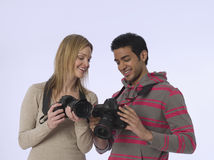 Couple With Digital Cameras Royalty Free Stock Images