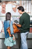 Couple With Digital Tablet At Butchery Royalty Free Stock Image